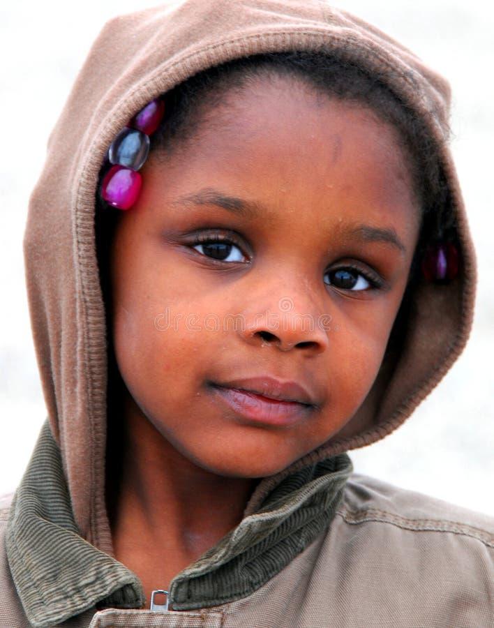 Niño étnico pobre foto de archivo libre de regalías