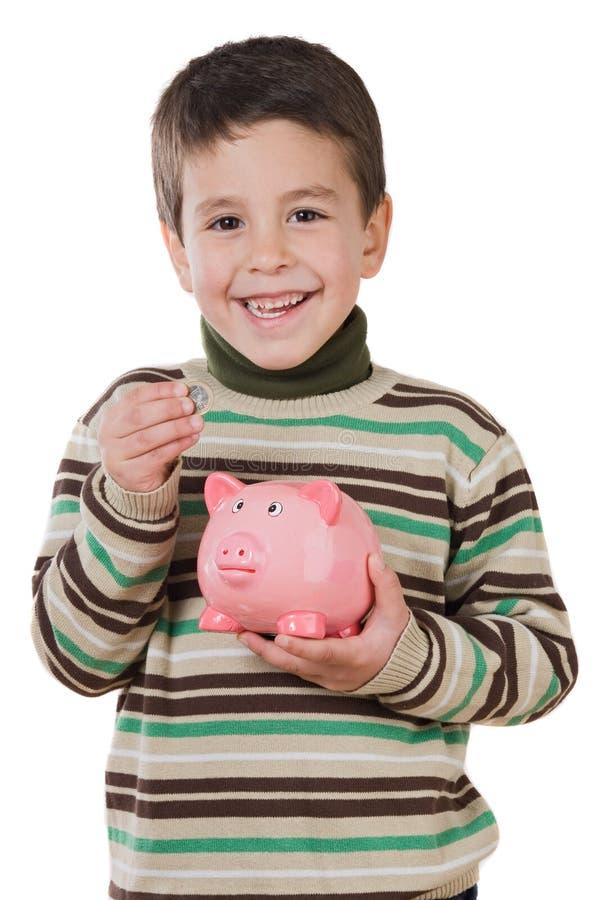 Niño adorable con ahorros del moneybox imagen de archivo libre de regalías
