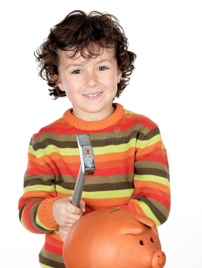 Niño adorable con el rectángulo del martillo y de dinero aislado foto de archivo libre de regalías
