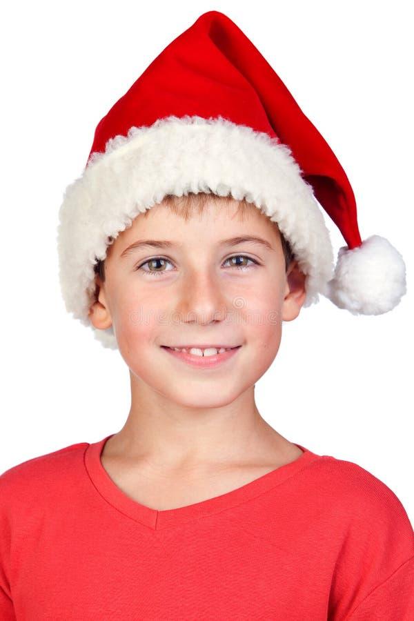 Niño adorable con el sombrero de Santa fotos de archivo