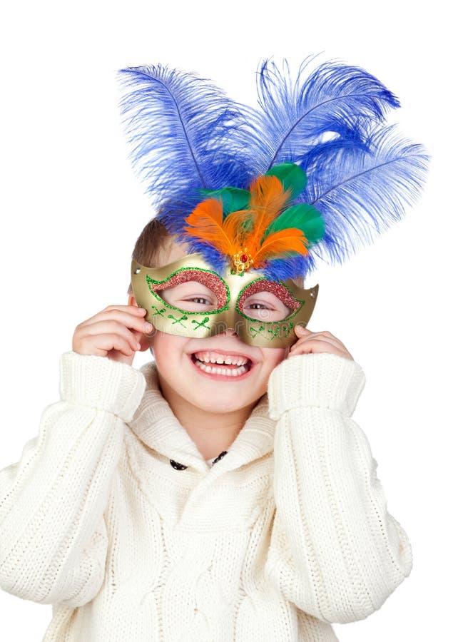 Niño adorable con la máscara del carnaval imagenes de archivo