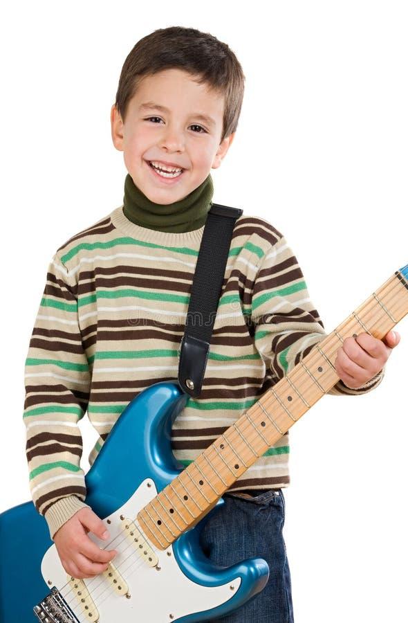 Niño adorable que toca la guitarra eléctrica foto de archivo libre de regalías