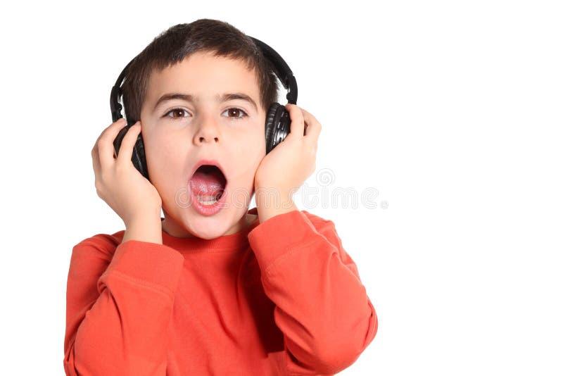Niño con el auricular fotos de archivo