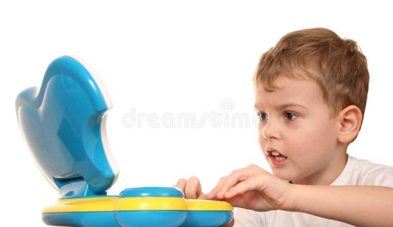 Niño con el cuaderno imagen de archivo