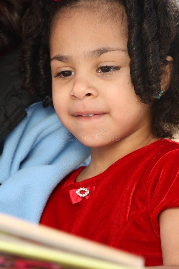 Niño con el libro fotos de archivo libres de regalías