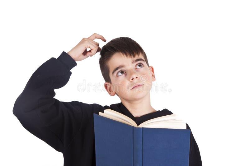 Niño con el libro aislado fotos de archivo