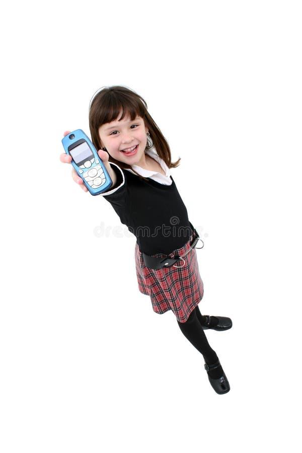 Niño con el teléfono celular foto de archivo libre de regalías