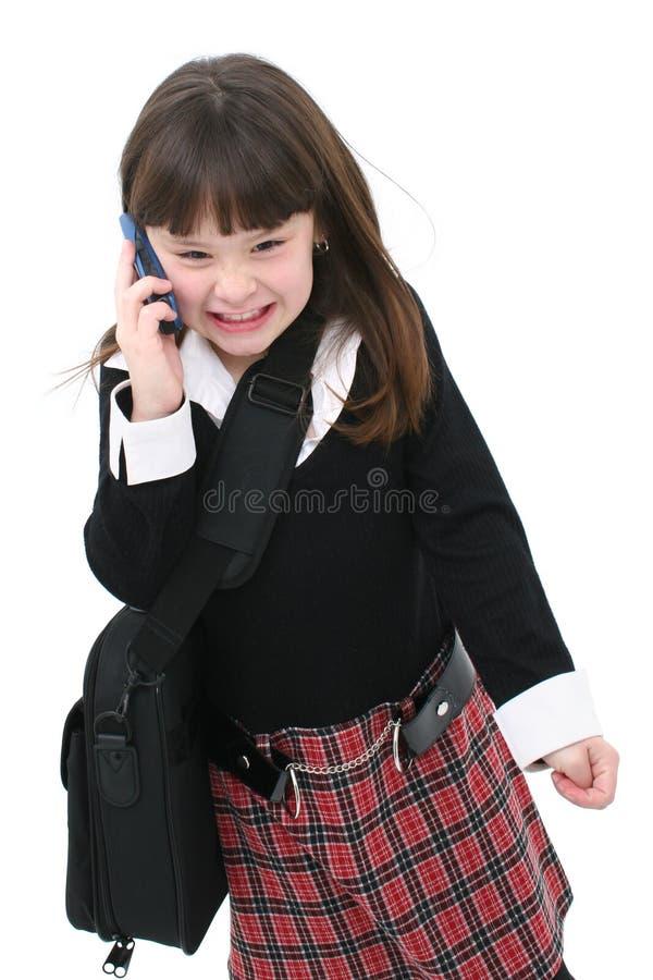 Niño con el teléfono celular foto de archivo