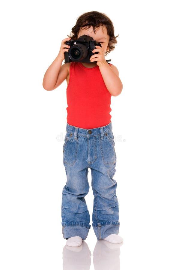 Niño con la cámara. imagen de archivo
