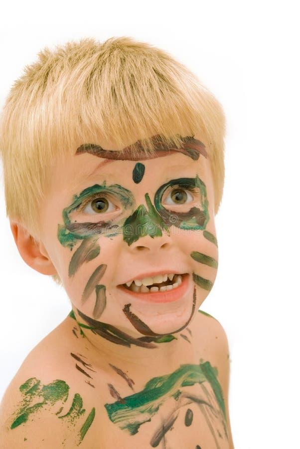 Niño con la cara pintada. fotografía de archivo