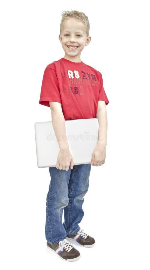 Niño con la computadora portátil imágenes de archivo libres de regalías
