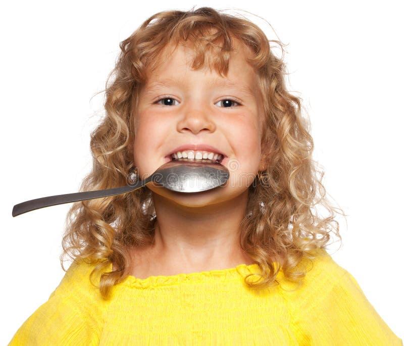 Niño con la cuchara foto de archivo