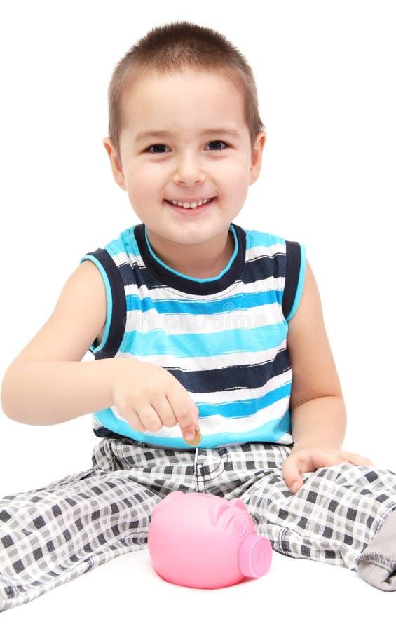 Niño con la hucha imagen de archivo