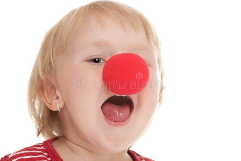 Niño con la nariz del payaso imagenes de archivo