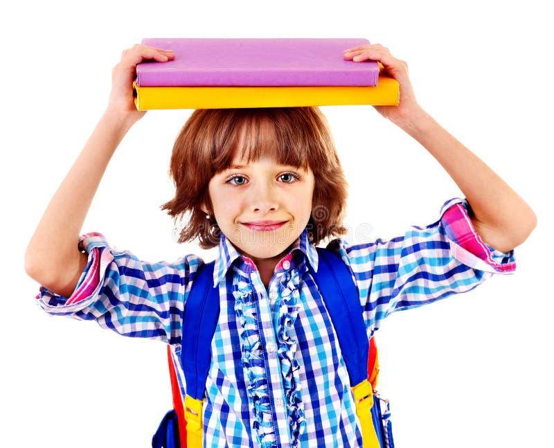 Niño con la pila de libros. imagenes de archivo