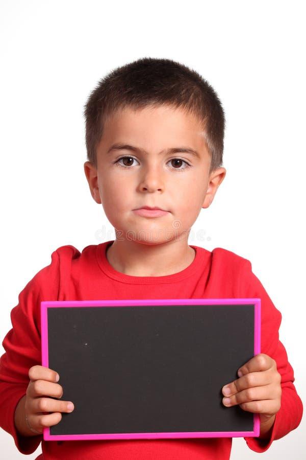 Niño con la pizarra vacía imágenes de archivo libres de regalías