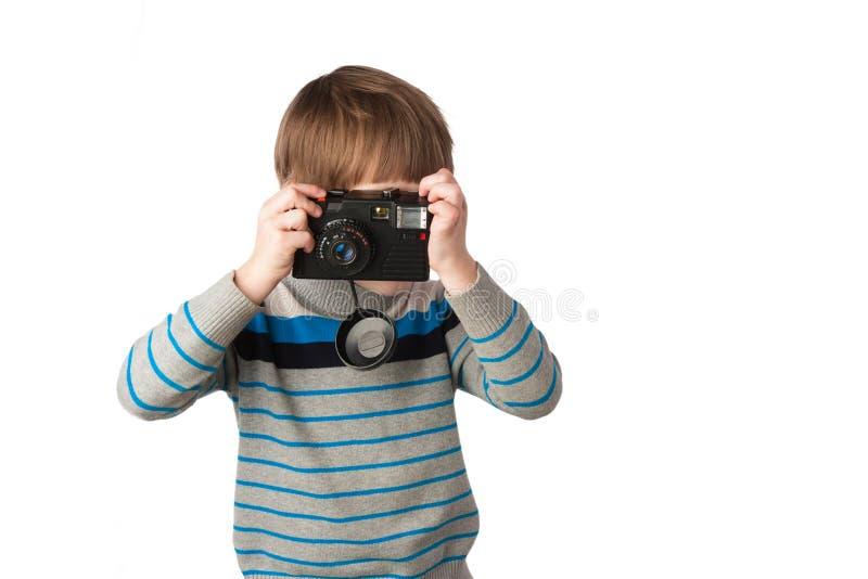 Niño con una cámara foto de archivo
