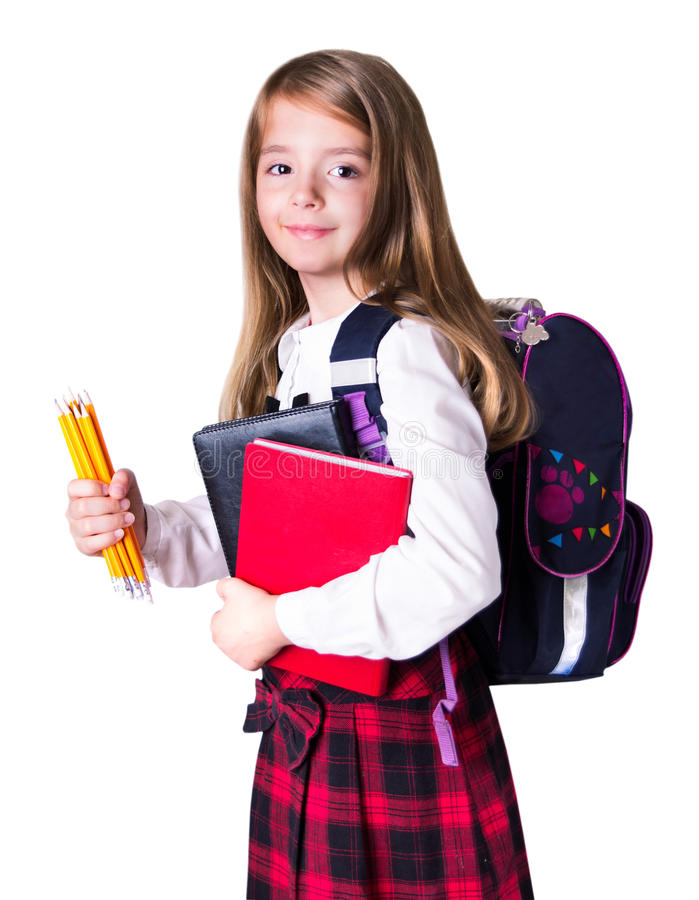 Niño de la colegiala con las fuentes de escuela aisladas en blanco fotografía de archivo libre de regalías