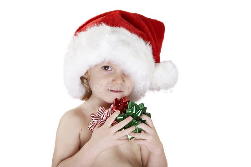 Niño de Santa con los arqueamientos de la Navidad imagenes de archivo