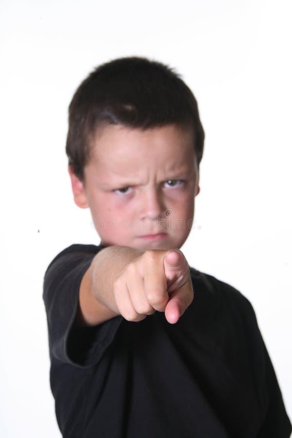 Niño de TYoung que hace una cara foto de archivo libre de regalías
