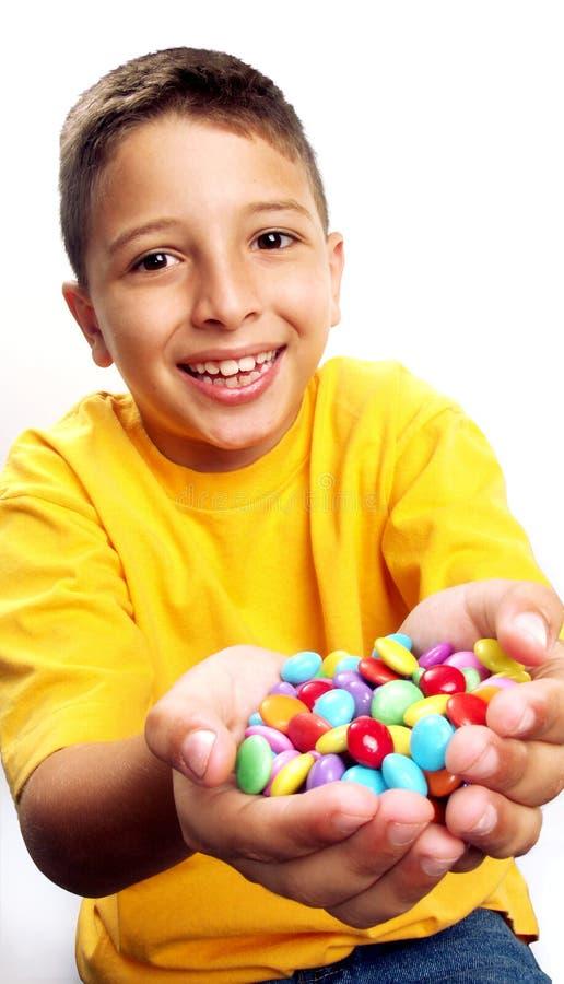 Niño del caramelo. imagenes de archivo