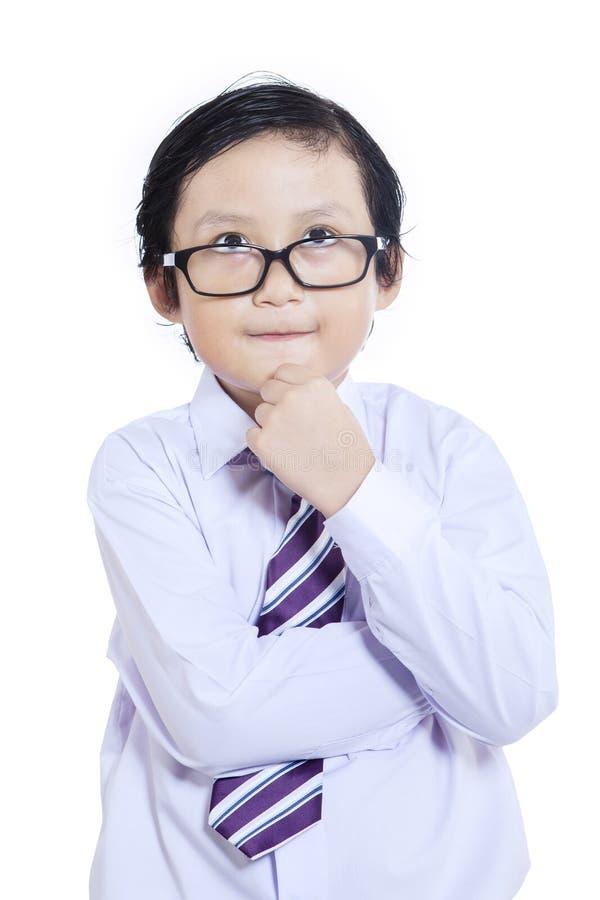 Niño del negocio del primer que piensa - aislado fotografía de archivo libre de regalías