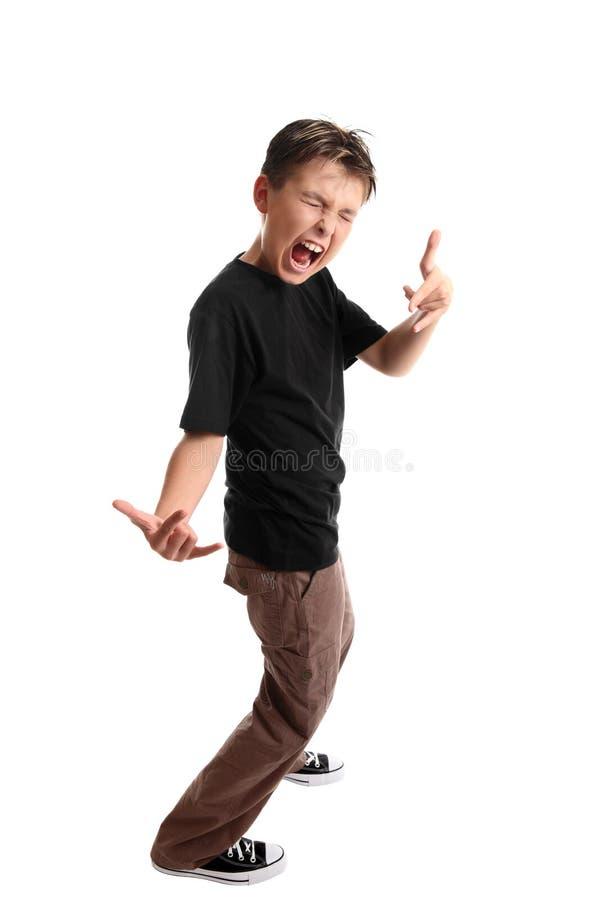 Niño del rodillo de la roca n fotos de archivo