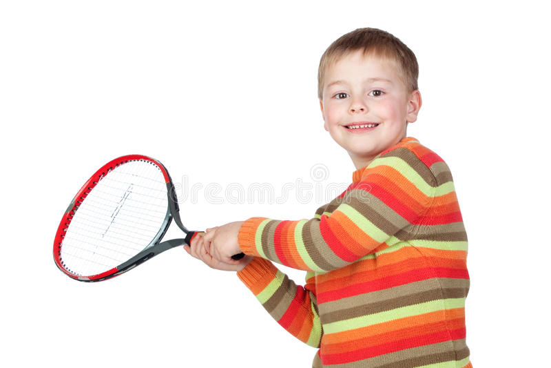 Niño divertido con una raqueta de tenis foto de archivo libre de regalías