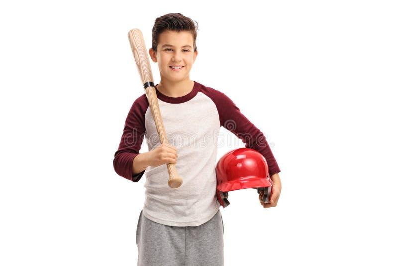 Niño encantado con un bate de béisbol y un casco fotografía de archivo libre de regalías