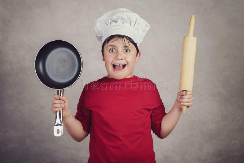 Niño enojado del cocinero imagen de archivo libre de regalías