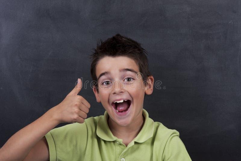Niño feliz en la escuela imagen de archivo libre de regalías