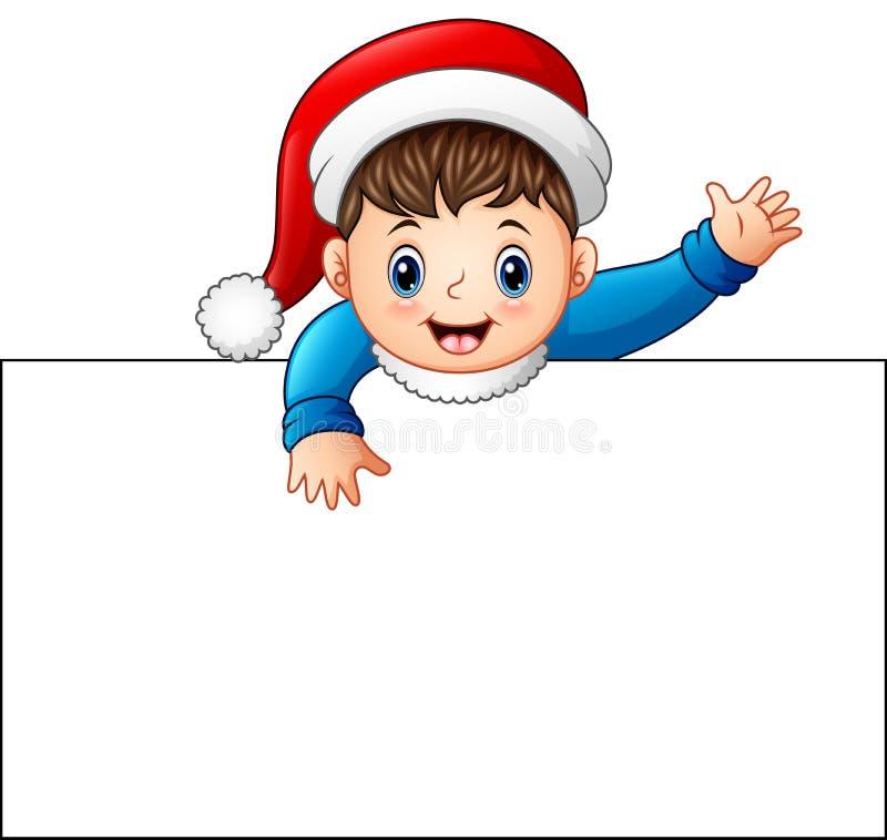 Niño feliz que lleva el casquillo de santa que lleva a cabo la muestra en blanco stock de ilustración