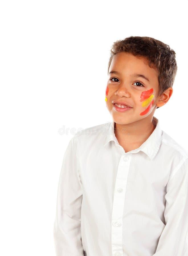 Niño hermoso con la bandera española de los colores pintada en su cara fotografía de archivo libre de regalías