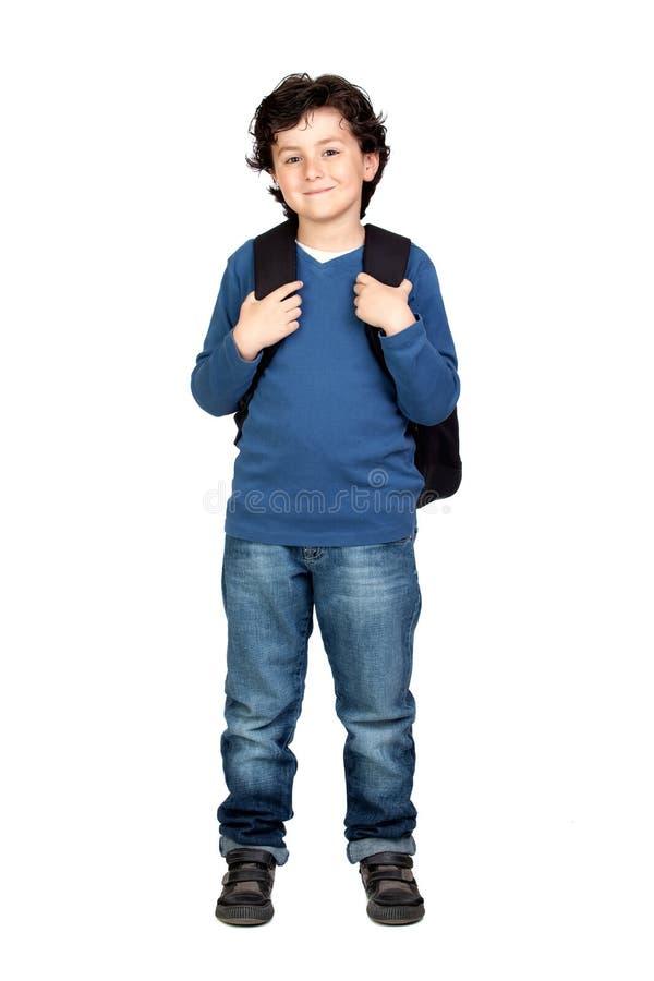 Niño hermoso del estudiante con el morral pesado foto de archivo libre de regalías