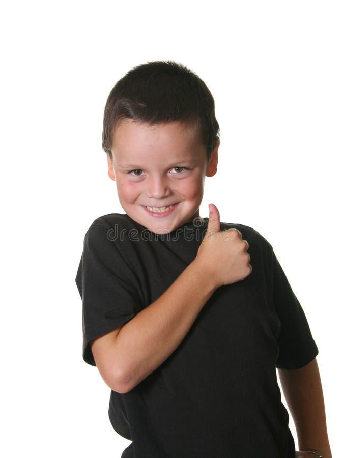 Niño joven con manierismos expresivos imagen de archivo libre de regalías