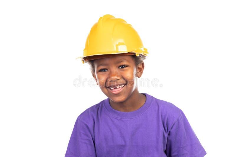 Niño lindo con el casco amarillo imagen de archivo libre de regalías