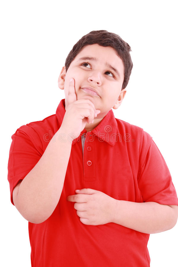 Niño lindo con una expresión pensativa fotos de archivo