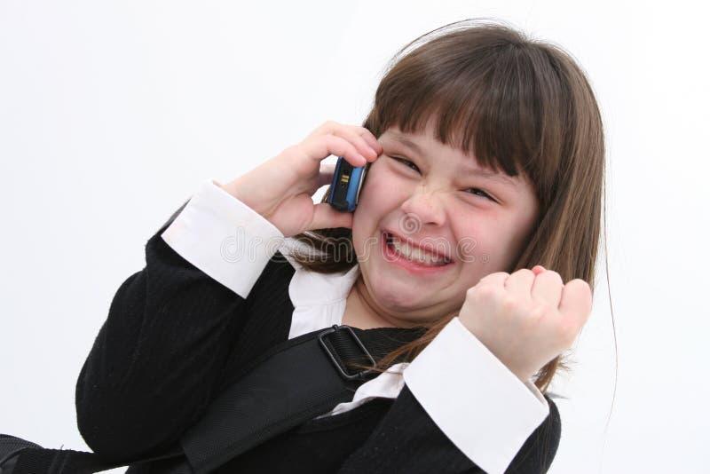 Niño (muchacha) en el teléfono celular 01 fotos de archivo libres de regalías