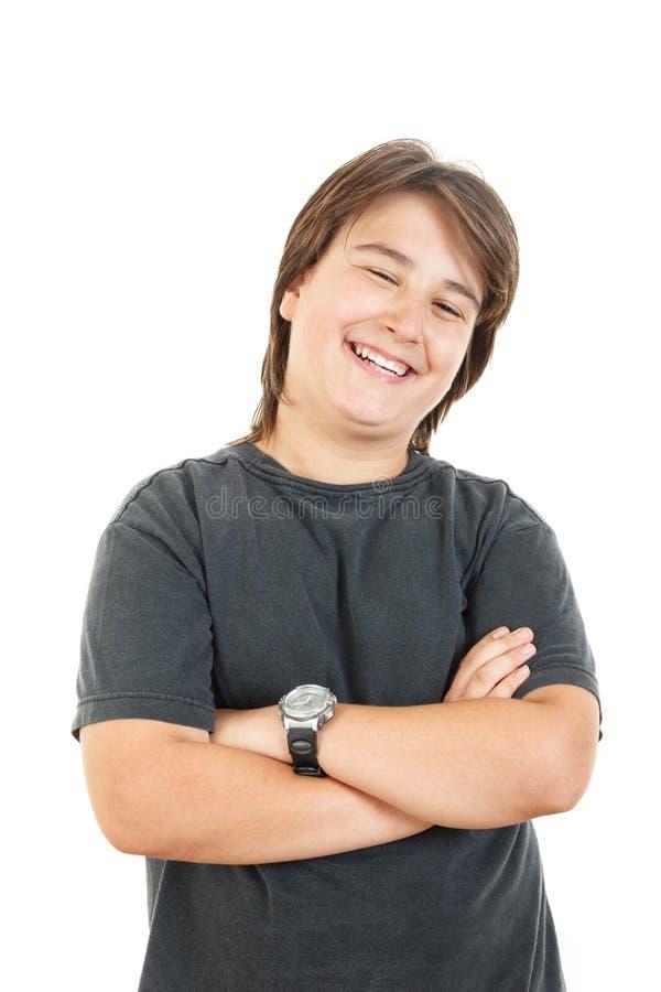 Niño o muchacho rechoncho masculino que sonríe y que presenta con confianza imagenes de archivo
