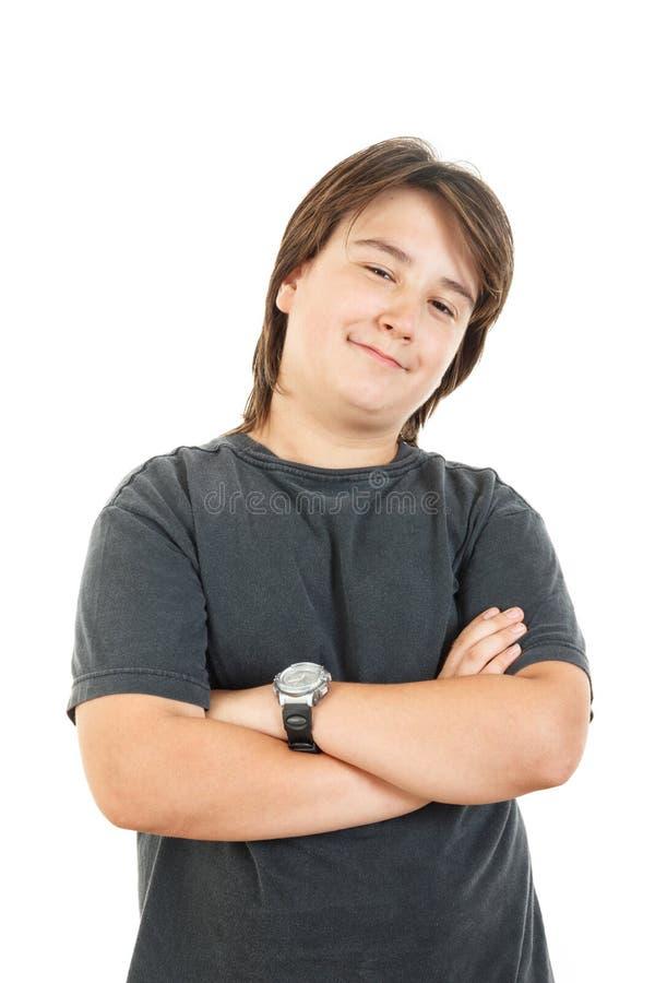 Niño o muchacho rechoncho que sonríe y que presenta con confianza fotografía de archivo
