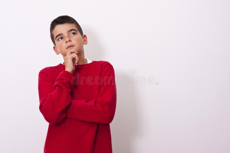 Niño pensativo fotografía de archivo