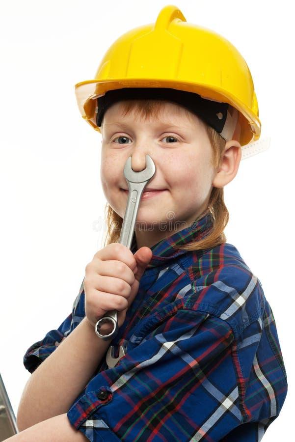 Niño pequeño con la herramienta de la llave fotografía de archivo libre de regalías