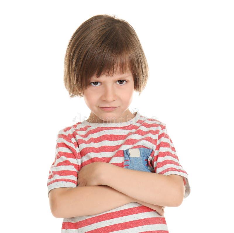 Niño pequeño descontentado en el fondo blanco imagen de archivo libre de regalías