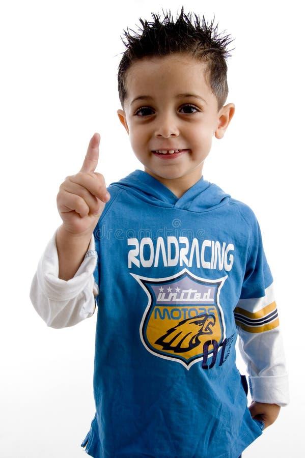 Niño pequeño que muestra el dedo fotografía de archivo