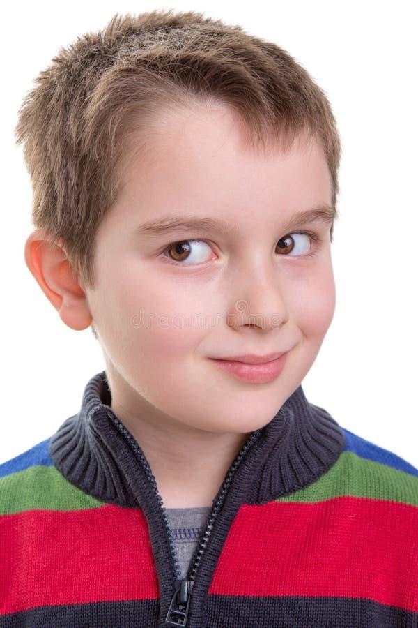 El niño da una mirada lateral fotografía de archivo libre de regalías