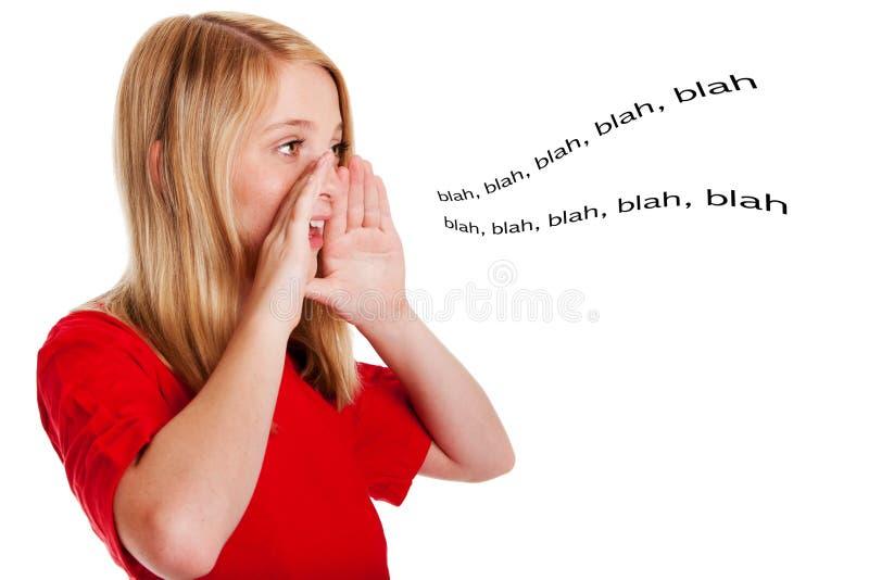 Niño que habla hacia fuera ruidosamente fotos de archivo libres de regalías