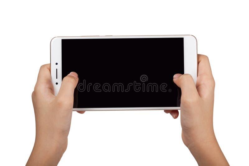 Niño que sostiene un smartphone con ambas manos fotos de archivo