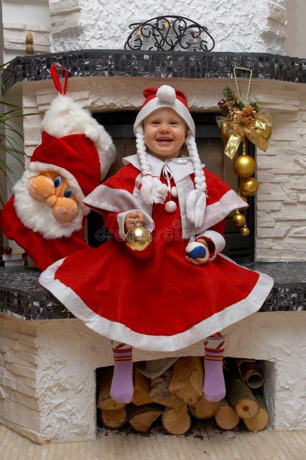 Niño sonriente de Santa de la Navidad imagenes de archivo