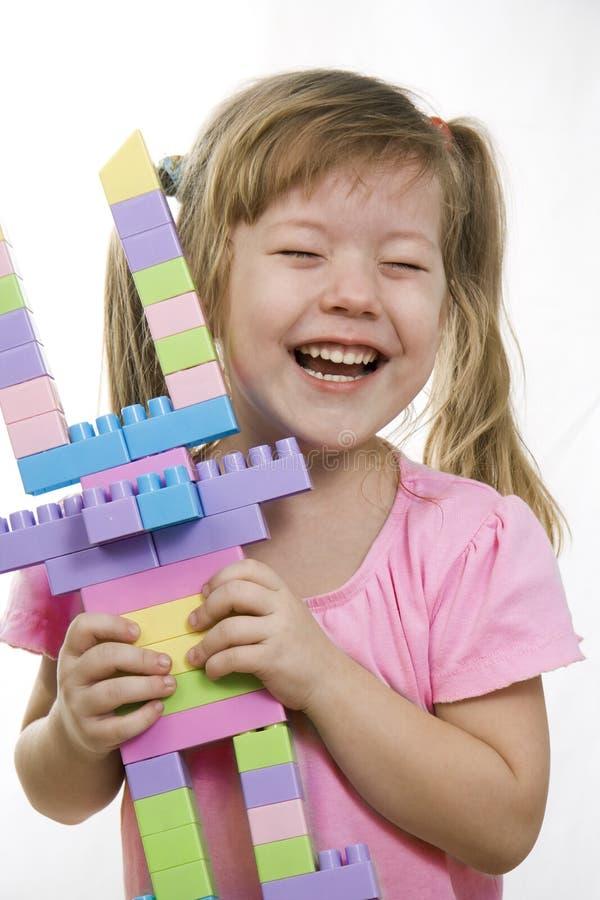 Niño y juguete fotografía de archivo