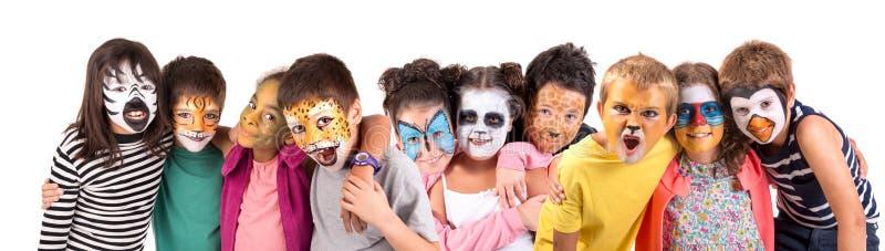 Niños con la cara-pintura imagen de archivo